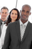 Multi-ethnic Business group looking at camera — Stock Photo
