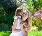 Little girl kissing her mother — Stock Photo
