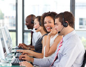 Smiling businesswoman working in a call center — Stock Photo