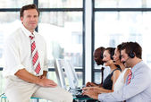 Confident senior manager in a call center — Stock Photo