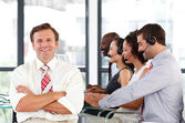Senior leadership with folded arms in a call center — Stock Photo