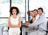 Multi-ethnic business team in a call center — Stock Photo
