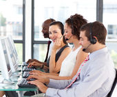 Beautiful young businesswoman in a call center — Stock Photo
