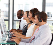 Attractive African-American businessman in a call center — Stock Photo