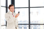 Senior businessman sending an sms with copy-space — Stock Photo