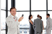 Senior Businessman being Positive with team in Background — Stockfoto