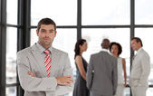 Young businessman being Positive with team in Background — Stock Photo