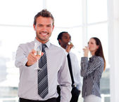 Businessman drinking champagne and celebrating a success — Stock Photo