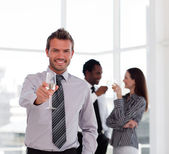 Happy businessman celebrating a success with champgane — Stock Photo