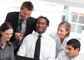 Multi-ethnic business team together in an office — Stock Photo