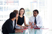 Business team interacting to each other in office — Stock Photo