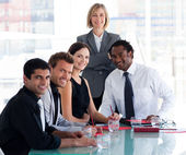 Business team smiling at the camera in office — Stock Photo