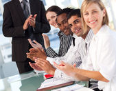 Business team applauding in a meeting — Stock Photo