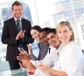 Happy businessteam after a presentation — Stock Photo