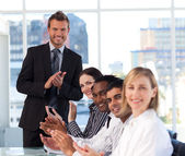 Businessman applauding with his team in a meeting — Стоковое фото