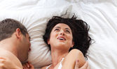 Lovely couple on a bed — Stock Photo