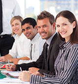 Businesswoman in an office with her colleagues — Stock Photo