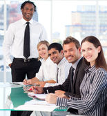 Happy business leader with his team in a meeting — Stock Photo