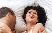 Loving couple in a bedroom — Stock Photo