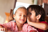 Cute boy talking to his sister — Stock Photo