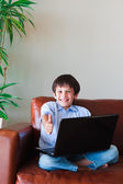 Young kid using his laptop — Stock Photo