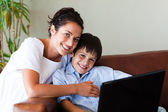 Mother and son playing with a laptop — Stock Photo