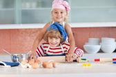 Lovely children baking at home — Stock Photo
