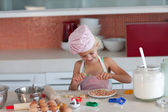 Lovely girl baking in a kitchen — Stock Photo