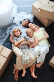 Family sleeping in its new house — Stock Photo