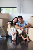 Happy couple in their new house with copy-space — Stock Photo