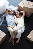 Happy couple relaxing in their new house — Stock Photo