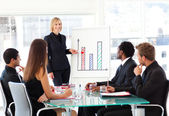 Businesswoman reporting to sales in a seminar — Stock Photo