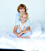 Nice children in a bedroom — Stock Photo