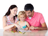 Parents helping their daughter doing homework — Stock Photo