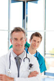 Young doctor in focus in a line — Stock Photo