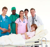 Doctors attending to a patient — Stock Photo