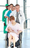 Mother in a weelchair with her newborn baby — Stock Photo