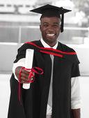 Man smilling at graduation — Stock Photo