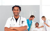 International doctors attending to a patient — Stock Photo