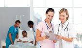 Group of doctors attending to a patient — Stock Photo