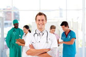 Doctor with folded arms smiling at the camera — Stock Photo