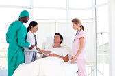 Doctors caring for a patient — Stock Photo