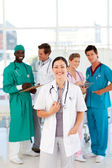 Doctor with colleagues in the background — Foto Stock