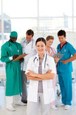 Smiling female doctor with her team — Stock Photo