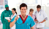 Portrait of a doctor with his team in the background — Stock Photo