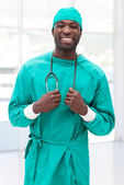 Attractive male doctor looking at the camera — Stockfoto