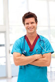 Portrait of a handsome male doctor looking at the camera — Stock Photo