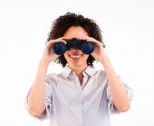 Close-up of Afro-American businesswoman holding binoculars — Stock Photo