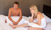 Couple sitting on bed in silence — Stock Photo