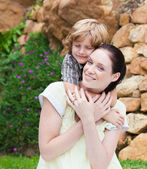 Nice kid embracing his mother — Stock Photo